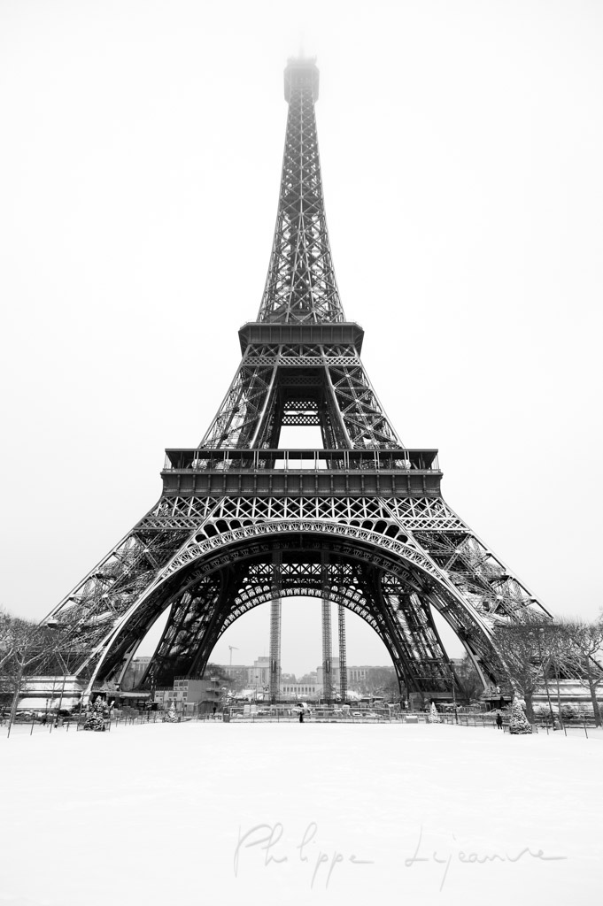 Eiffel tower under the snow from the Champs de mars in Paris - black and white
