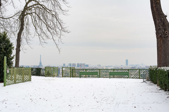 Paris under the snow from a high point of view in the Parc de Saint-Cloud, France