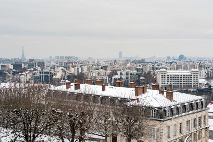 Paris under the snow from the Parc de Saint-Cloud, France