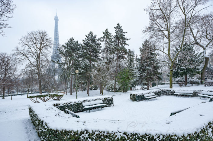 Trocadero gardens under the snow with the Eiffel tower in the background, Paris, France