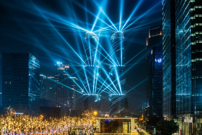 Chengdu, Sichuan province, China : Jiaozi Financial street twin towers lightshow at night in the business district of the city.