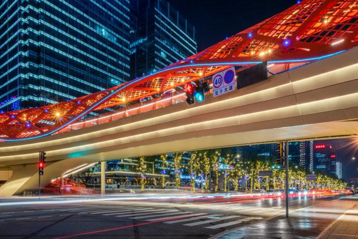 Car traffic light trails at night at Jiaozi ring bridge in Chengdu, Sichuan province, China